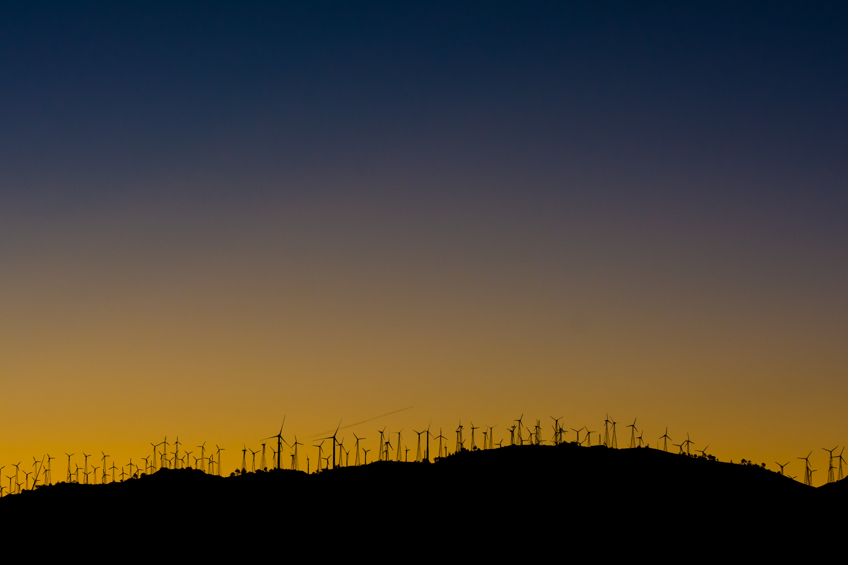 Renewable Energy Construction Photography | Wind Turbines at Sunrise